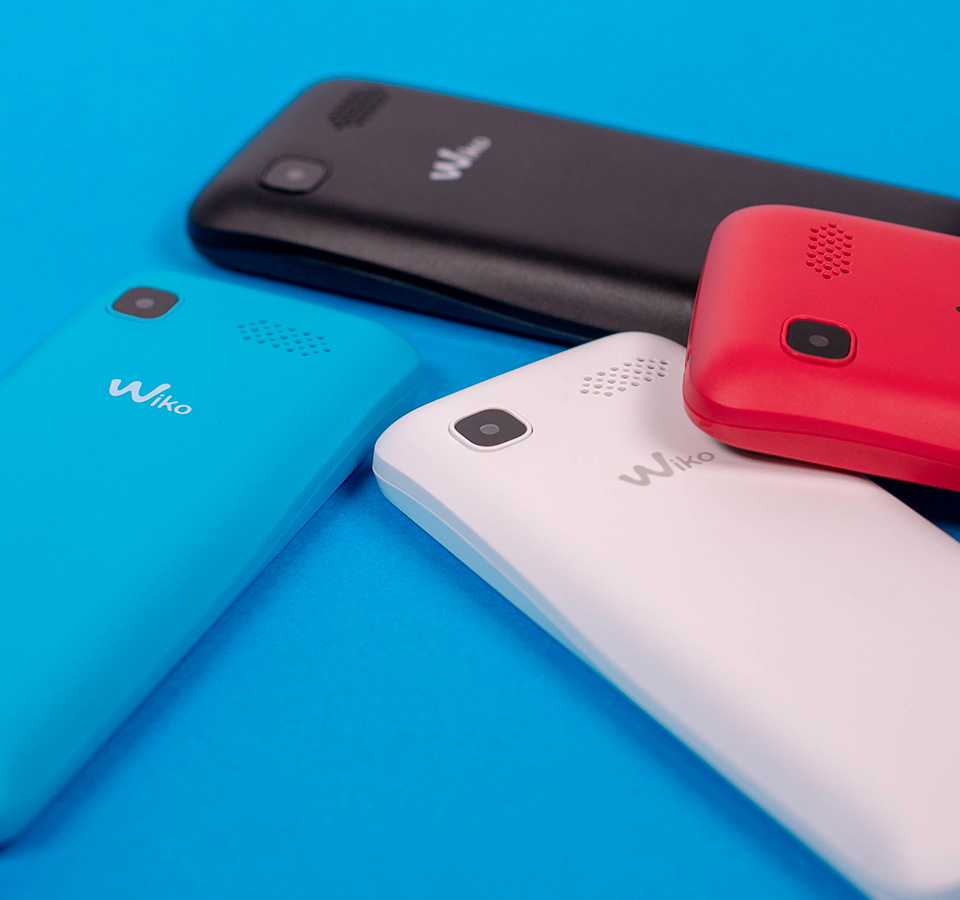 Four colours of the Lubi5 Mobiles displayed on a blue background